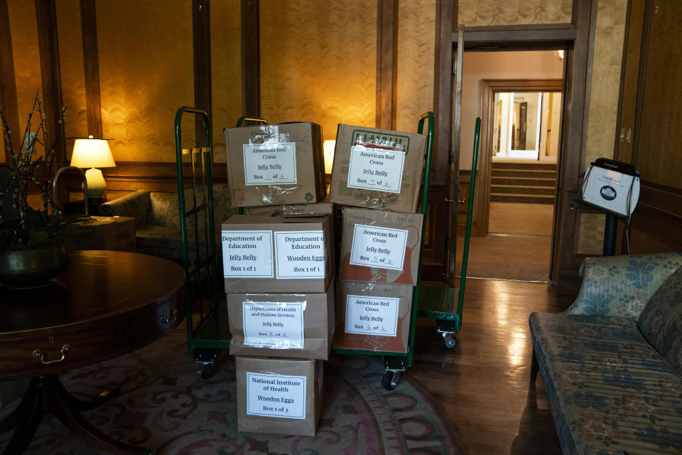 Boxes of wooden Easter eggs sit in boxes at the White House waiting to be delivered to organizations in the area Wednesday, April 8, 2020, in Washington. With the annual White House Easter Egg Roll canceled due to concerns about large gatherings during the coronavirus pandemic, first lady Melania Trump is giving 25,000 commemorative Easter eggs to area children's hospitals, federal agencies, aid groups and grocery store chains. (AP Photo/Evan Vucci)