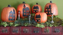 "<p>A passel of pumpkins provides the backdrop for a quaint village scene.</p><p><strong>Step 1: </strong>Carve a hole in the bottom of each pumpkin, scoop out the pulp, and return the cut pieces. </p><p><strong>Step 2:</strong> Print out <a href=""http://clv.h-cdn.co/assets/cm/15/24/5578ad54eb003_-_hauntedhouses.pdf"" rel=""nofollow noopener"" target=""_blank"" data-ylk=""slk:these house templates."" class=""link rapid-noclick-resp"">these house templates.</a> Resize on a copier, scaling the images to fit your pumpkins.</p><p><strong>Step 3:</strong> Cut out stencils as directed on the templates and affix to pumpkins with masking tape. Trace on the designs with a felt-tip pen. </p><p><strong>Step 4:</strong> Remove stencils, then carefully carve along the drawn lines of the houses' windows with an X-Acto knife. Fill in the designs using a fine-tip brush and black flat acrylic paint; let dry. Affix a battery-operated votive candle in the base of each pumpkin with adhesive putty. </p><p><a class=""link rapid-noclick-resp"" href=""https://www.amazon.com/Homemory-Realistic-Flickering-Flameless-Celebration/dp/B01EDKGFGU/?tag=syn-yahoo-20&ascsubtag=%5Bartid%7C10050.g.1350%5Bsrc%7Cyahoo-us"" rel=""nofollow noopener"" target=""_blank"" data-ylk=""slk:SHOP TEA LIGHTS"">SHOP TEA LIGHTS</a><br></p>"