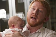 Democratic gubernatorial candidate, Del. Lee Carter, D-Manassas, holds his baby girl, Charlotte, during an interview prior to the last primary debate in Newport News, Va., Tuesday, June 1, 2021. Carter faces four other Democrats in the primary June 8. (AP Photo/Steve Helber)