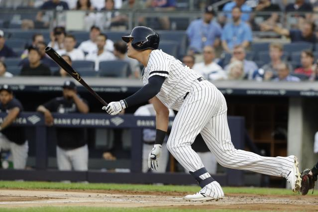 New York Yankees' Gio Urshela follows through on a single during the first inning of a baseball game against the Cleveland Indians, Friday, Aug. 16, 2019, in New York. (AP Photo/Frank Franklin II)