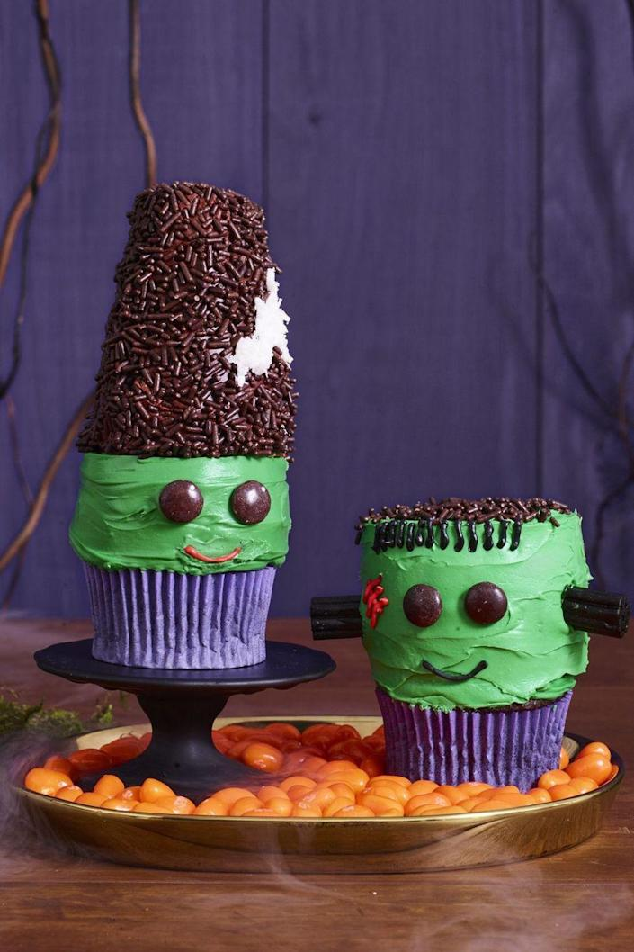 """<p>Decorate store-bought cupcakes or bake your own for this recipe that uses green frosting, chocolate sprinkles, and shredded coconut.<a href=""""https://www.womansday.com/food-recipes/food-drinks/a23570068/frankenstein-and-his-bride-cupcakes-recipe/"""" rel=""""nofollow noopener"""" target=""""_blank"""" data-ylk=""""slk:"""" class=""""link rapid-noclick-resp""""><br></a></p><p><strong><em><a href=""""https://www.womansday.com/food-recipes/food-drinks/a23570068/frankenstein-and-his-bride-cupcakes-recipe/"""" rel=""""nofollow noopener"""" target=""""_blank"""" data-ylk=""""slk:Get the Frankenstein and His Bride Cupcakes recipe."""" class=""""link rapid-noclick-resp"""">Get the Frankenstein and His Bride Cupcakes recipe.</a></em></strong></p>"""