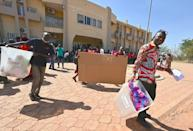 Election workers heading for a polling station in Ouagadougou on Saturday to set up the ballot boxes