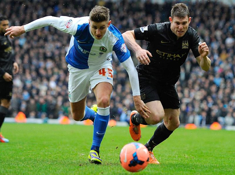 Blackburn Rovers' English midfielder Tom Cairney (L) during the FA Cup third round football match between Blackburn Rovers and Manchester City at Ewood Park in Blackburn on January 4, 2014