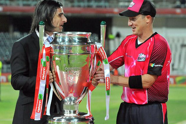 Brad Haddin (R) of the Sixers receives the trophy from Dean Kino after the Karbonn Smart CLT20 Final match between bizhub Highveld Lions and Sydney Sixers at Bidvest Wanderers Stadium on October 28, 2012 in Johannesburg, South Africa. (Photo by Duif du Toit/Gallo Images/Getty Images)