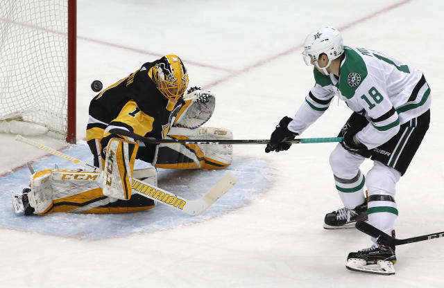 Pittsburgh Penguins goaltender Casey DeSmith (1) stops a shot by Dallas Stars' Tyler Pitlick (18) in the first period of an NHL hockey game in Pittsburgh, Sunday, March 11, 2018. (AP Photo/Gene J. Puskar)