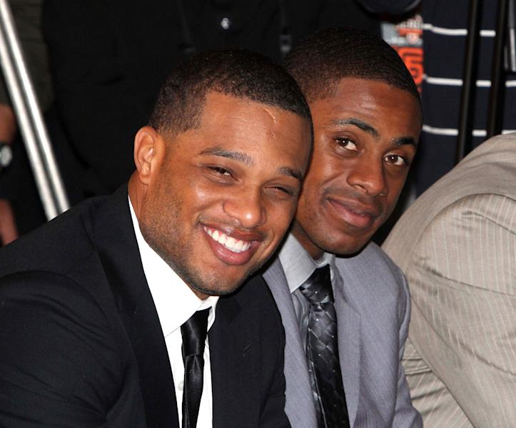 "FILE - In this Oct. 30, 2011 file photo, Robinson Cano of the New York Yankees, left, and teammate Curtis Granderson smile during a press conference for a baseball series in Taipei, Taiwan. The Seattle Mariners say that cannot confirm any details of a potential deal with free agent Cano. The team said Friday morning, Dec. 6, 2013, they will announce if an agreement is ""completed and finalized"" with the Yankees star. The statement came in response to an ESPN report Friday morning that Cano and the Mariners had reached agreement on a $240 million, 10-year contract pending a physical. (AP Photo/Chiang Ying-ying, File)"