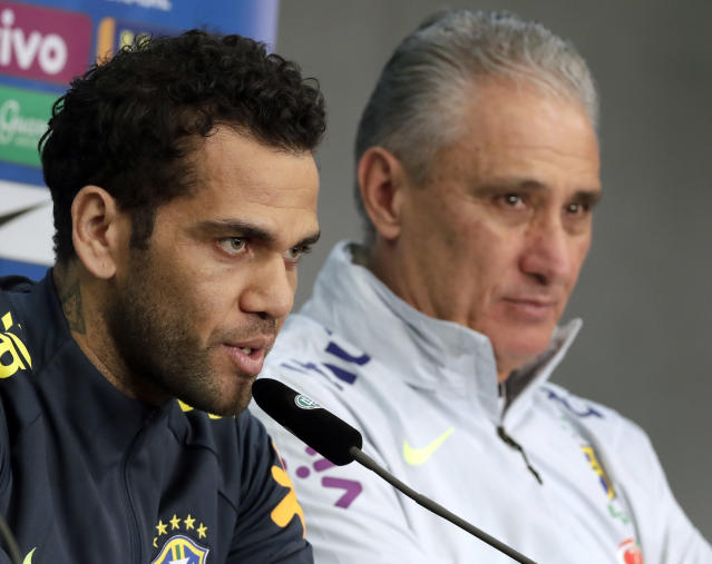 Brazil's head coach Tite, right, and player Dani Alves, left, address the media during a press conference after training session of the Brazilian national soccer team in Berlin, Germany, Monday, March 26, 2018. Brazil will face Germany for an international friendly soccer match on Tuesday, March 27, 2018 in Berlin. (AP Photo/Michael Sohn)