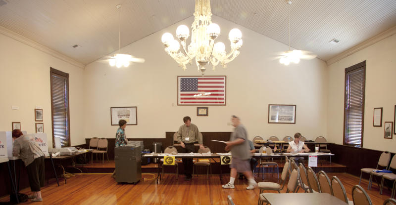 Primary election voters cast their ballots in Kanwaka Township Hall near Lawrence, Kan., Tuesday, Aug. 7, 2012.  Republican primary voters in Kansas could reshape the Legislature on Tuesday, with conservatives hoping to oust moderate GOP incumbents in the Senate who have stymied the right's political agenda. (AP Photo/Orlin Wagner)