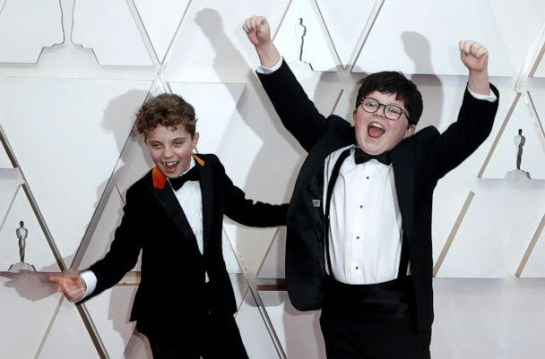 PHOTO: Roman Griffin Davis and Archie Yates react on the red carpet during the 92nd Academy Awards in Hollywood, Calif., Feb. 9, 2020. (Eric Gaillard/Reuters)