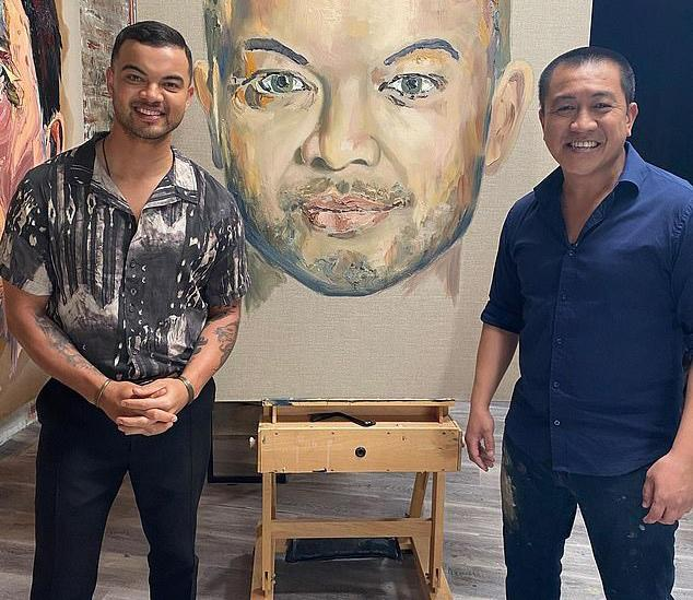 Guy Sebastian with his portrait by Ahn Do on Ahn's show 'Brush With Fame'