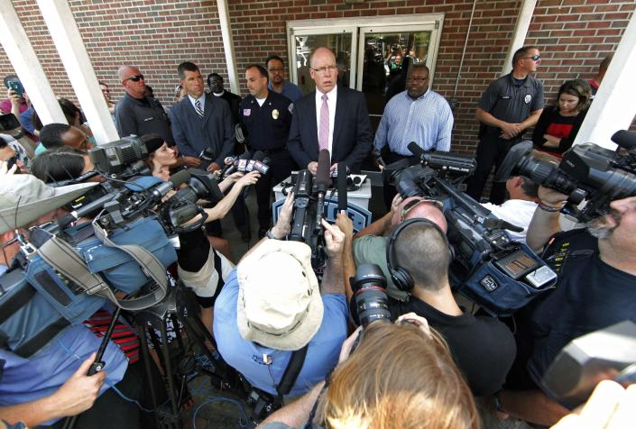 Shelby pastor Strickland Maddox said more than 100 reporters and gawkers gathered in the police department's parking lot after Roof's capture. (Photo: Jason Miczek/Reuters)