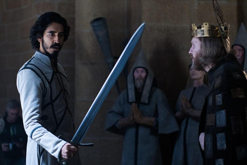 Gawain (Dev Patel, left) is lent King Arthur's (Sean Harris) sword, Excalibur, as he goes up against the Green Knight.