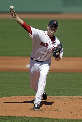 Boston Red Sox starting pitcher John Lackey (41) throws during the first inning of a baseball game against the Houston Astros at Fenway Park in Boston, Sunday, April 28, 2013. (AP Photo/Mary Schwalm)