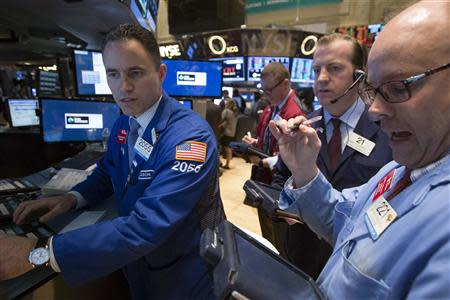 Traders work on the floor of the New York Stock Exchange April 15, 2014. REUTERS/Brendan McDermid