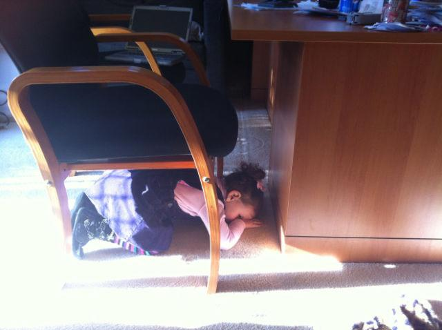 <p>She's either hiding or prepping for an earthquake.</p>