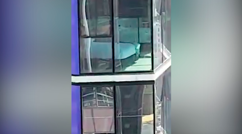 The couple pulled the blinds on their glass windows as soon as they noticed the unwanted audience. Photo: Facebook
