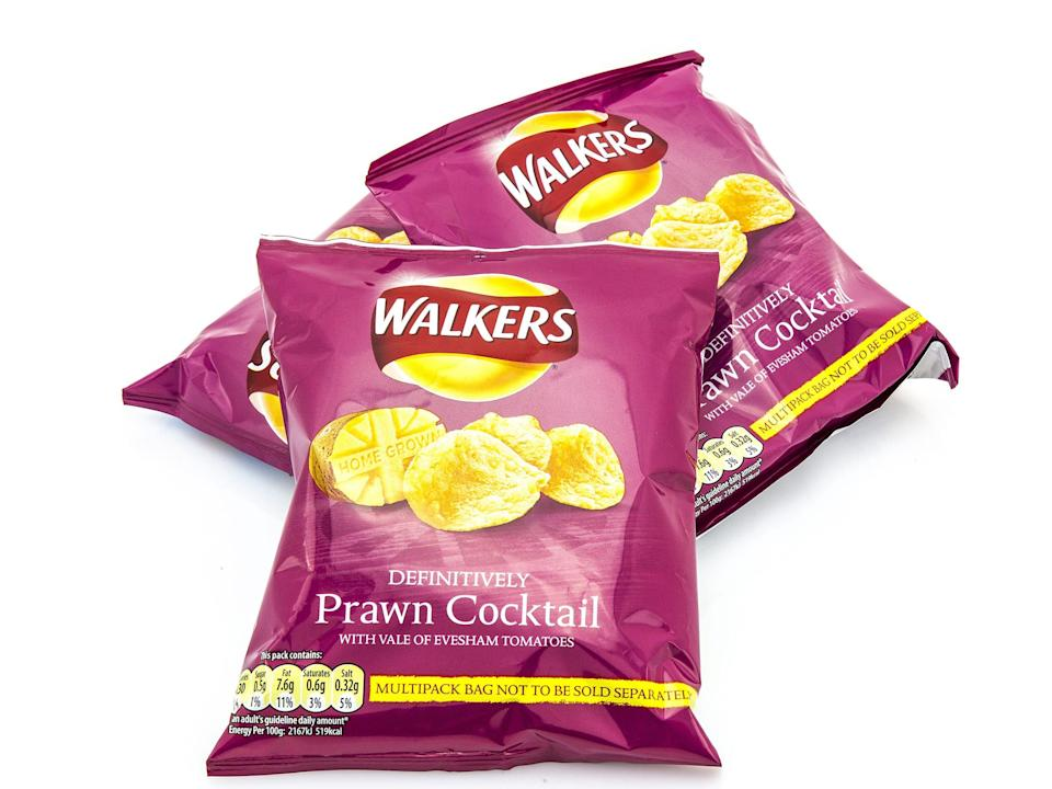 Walkers prawn cocktail crisps pink bags on white background