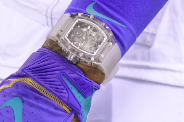 FILE - In this Sept. 16, 2019, file photo, Cleveland Browns' Odell Beckham wears a Richard Mille watch during warm ups before an NFL football game against the New York Jets, in East Rutherford, N.J. Football fashion plate Odell Beckham Jr. has switched watches. The Browns polarizing wide receiver has partnered with Swedish watchmaker Daniel Wellington, which introduced him Wednesday, Sept. 18, 2019, as one of our new icons. Beckham caused a minor uproar last week by wearing a nearly $200,000 Richard Mille watch during Clevelands home opener. (AP Photo/Bill Kostroun, File)