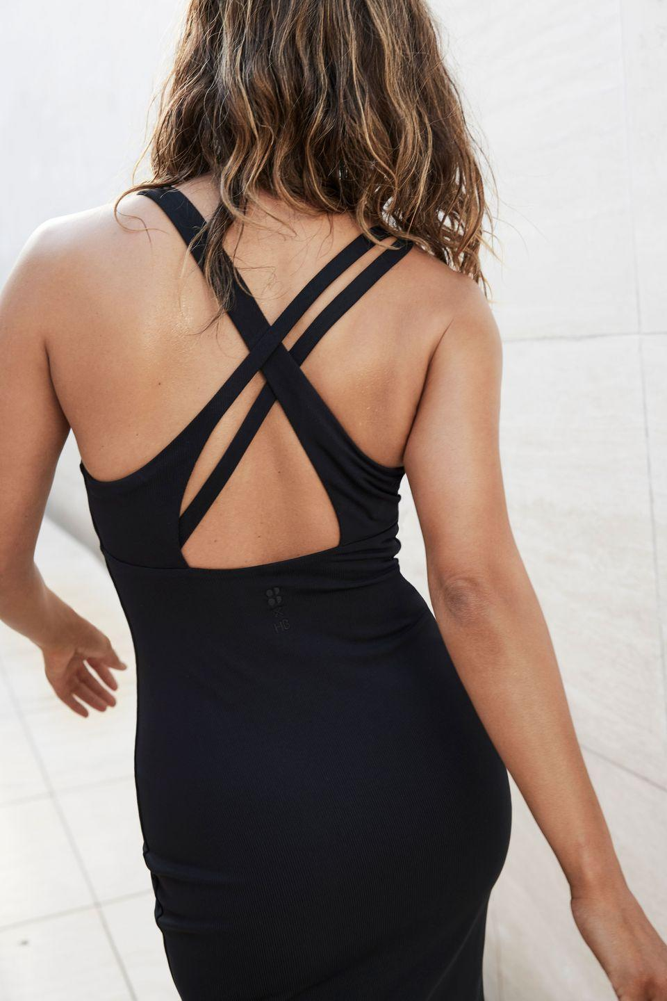 """<p>This slinky midi dress is the perfect dress to throw on after a sweaty cardio session. The stretch jersey fabric means you can roll it up in your gym bag and it will emerge crease-free for a pulled together look post-class. The strappy criss-cross back makes it a summer winner.</p><p><strong>How much? </strong>£120</p><p><a class=""""link rapid-noclick-resp"""" href=""""https://go.redirectingat.com?id=127X1599956&url=https%3A%2F%2Fwww.sweatybetty.com%2Fhalle-berry%2Fhalle-berry-edit%2Femily-strappy-back-dress-SB6911_Black.html%3Fdwvar_SB6911__Black_color%3Dblack%26cgid%3Dhalle-berry-edit%26tile%3D6.0%23start%3D6&sref=https%3A%2F%2Fwww.redonline.co.uk%2Ffashion%2Ffashion-news%2Fg36470632%2Fsweaty-betty-halle-berry%2F"""" rel=""""nofollow noopener"""" target=""""_blank"""" data-ylk=""""slk:SHOP NOW"""">SHOP NOW</a></p>"""
