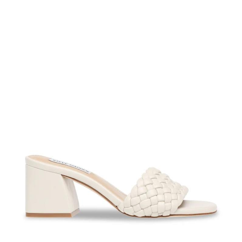 "89,99€<br><br><a href=""https://stevemadden.fr/collections/mules/products/aspyn-bone"" rel=""nofollow noopener"" target=""_blank"" data-ylk=""slk:Acheter"" class=""link rapid-noclick-resp"">Acheter</a>"