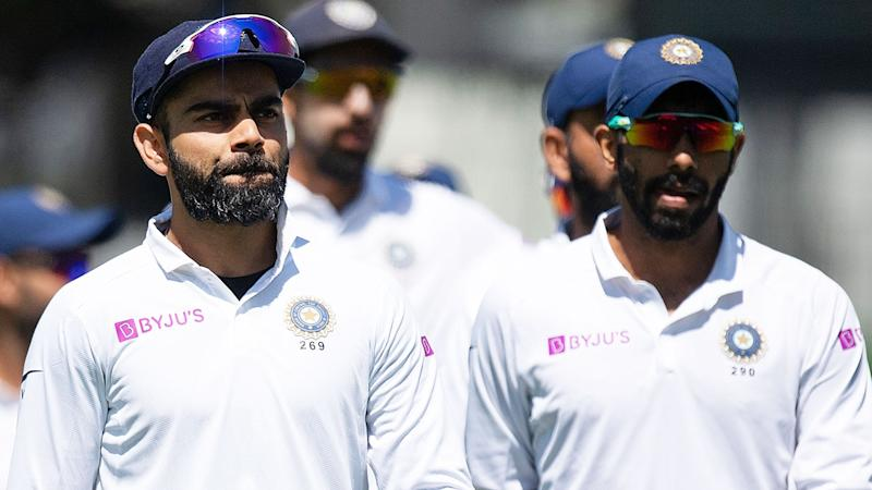Pictured here, India captain Virat Kohli looks glum after New Zealand's big first Test victory.