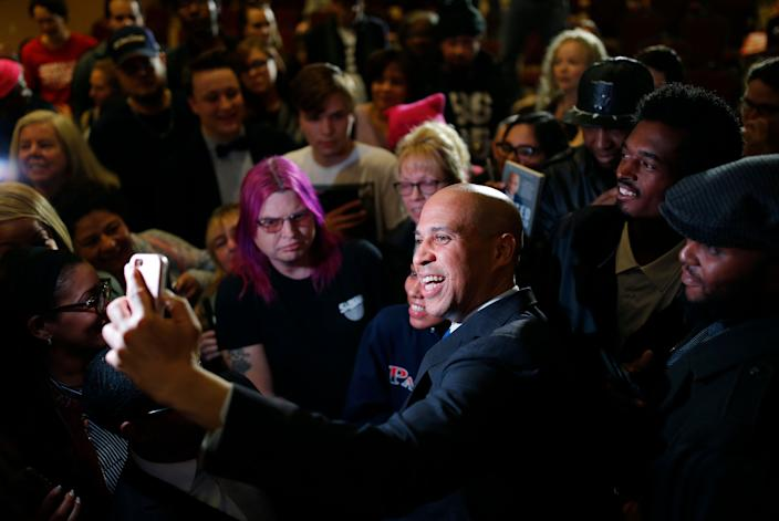 2020 Democratic presidential candidate Sen. Cory Booker takes a selfie with a supporter at an event Sunday, Feb. 24, 2019, in North Las Vegas, Nev. (AP Photo/John Locher)