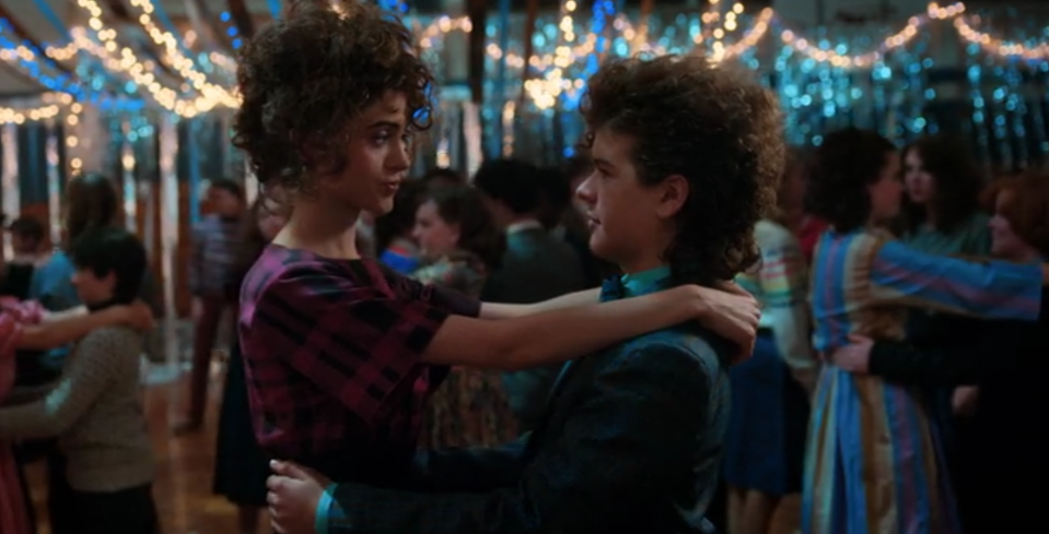 <p>Forget Demogorgons and Demo-dogs — nothing's more terrifying than getting rejected at the school dance. Dustin may be a hero when it comes to all things Upside Down (and one who rocks an amazing head of hair), but he winds up sitting alone on the bleachers while his friends pair up. Then Nancy saves him from social disaster by asking him to dance. Just look at his shining eyes while she gives him a pep talk and try to stop your heart from melting. —<em>KW</em><br>(Photo: Netflix) </p>