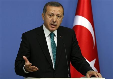Turkey's Prime Minister Tayyip Erdogan addresses the media in Ankara