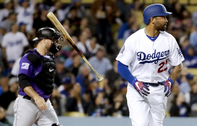 Los Angeles Dodgers' Matt Kemp watches his sacrifice fly against the Colorado Rockies during the fifth inning of a baseball game in Los Angeles, Wednesday, May 23, 2018. Austin Barnes scored on the play. (AP Photo/Chris Carlson)