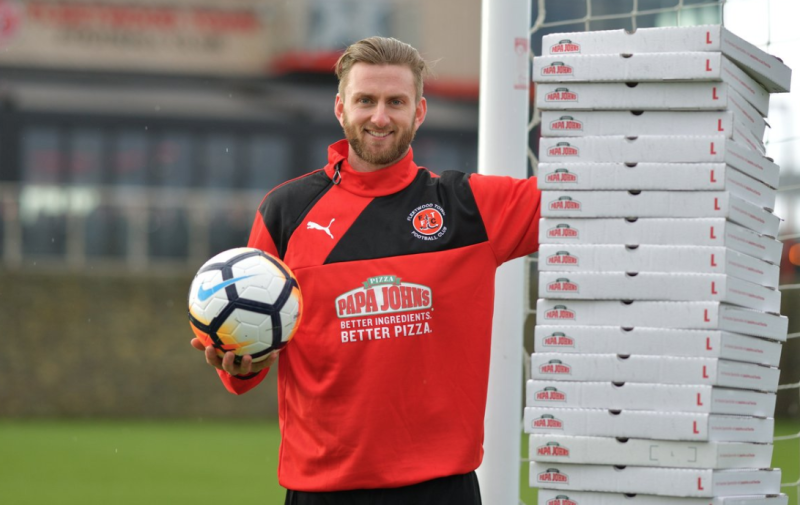 Fleetwood Town goalkeeper poses for a promotional photo. He'll get a year's supply of free pizza from Papa John's after keeping a clean sheet against Leicester in the FA Cup. (Papa John's UK on Twitter)
