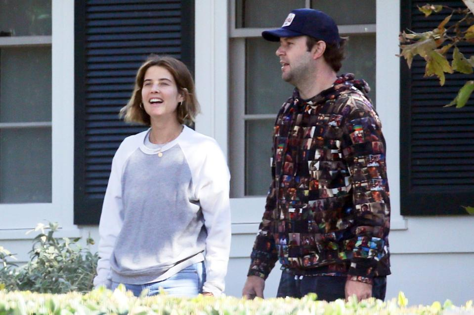 <p>Cobie Smulders and husband Taran Killam decorate their home in L.A. with Christmas lights on Tuesday.</p>