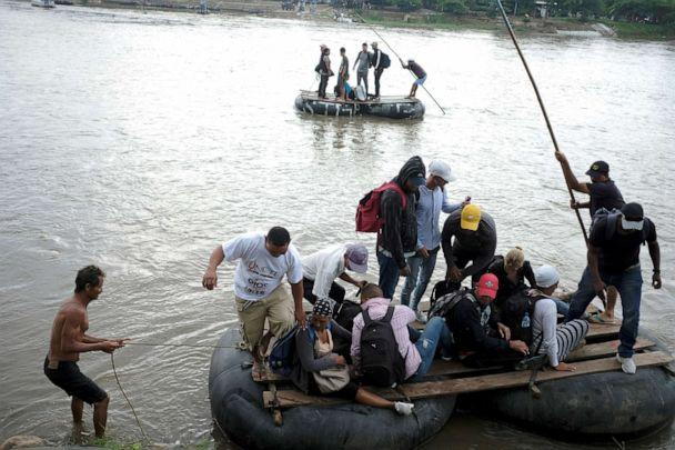 PHOTO: Central American migrants get off a raft after crossing the Suchiate river from Tecun Uman, in Guatemala, to Ciudad Hidalgo, as seen from Ciudad Hidalgo, Mexico, June 11, 2019. (Jose Cabezas/Reuters)