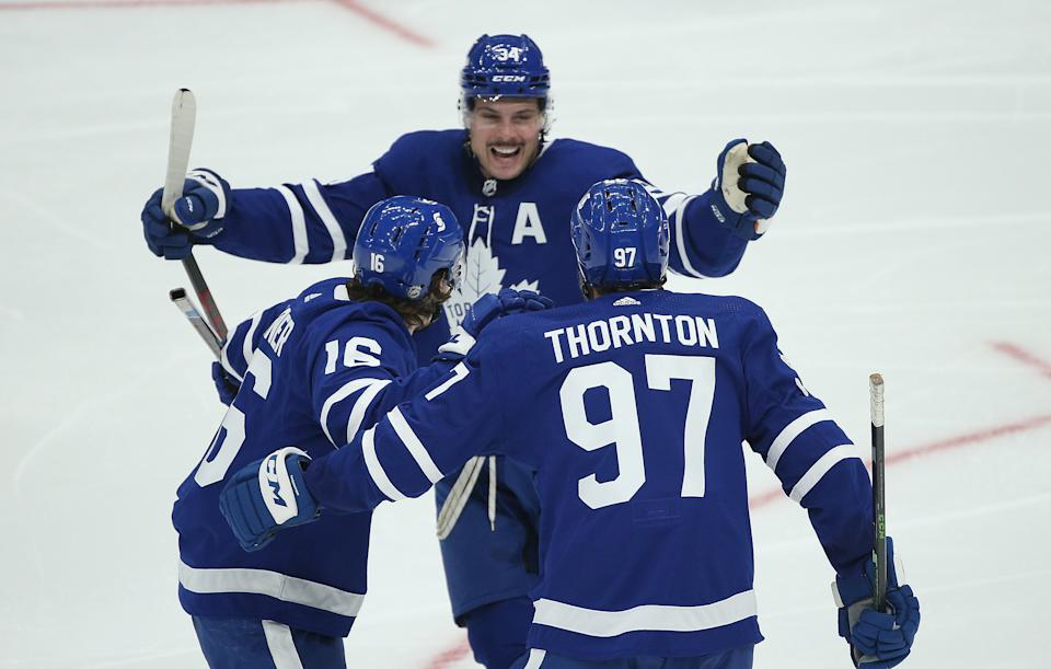 Toronto, ON- January 9  -  Toronto Maple Leafs center Joe Thornton (97) celebrates with Toronto Maple Leafs center Auston Matthews (34) after Toronto Maple Leafs center Mitch Marner (16) scores in second period action as the Toronto Maple Leafs hold their annual Blue versus White intersquad game  at ScotiaBank Arena in Toronto. January 9, 2021.     The game is played before an empty arena as Ontario faces stricter restrictions to slow the spread of the COVID-19 pandemic        (Steve Russell/Toronto Star via Getty Images)