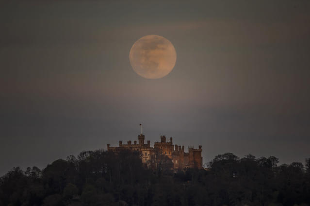 A pink supermoon is seen over Belvoir castle in Leicestershire on 7 April, 2020. (AP)