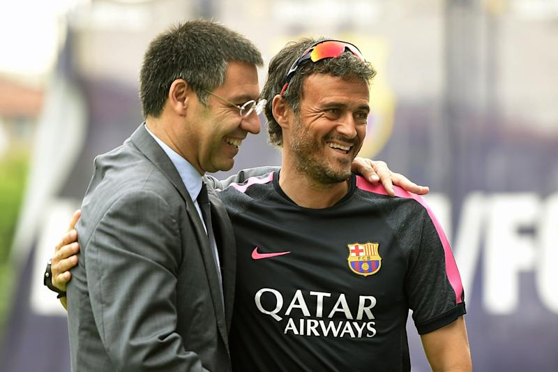 FC Barcelona president Josep Maria Bartomeu (L) welcomes team's new coach Luis Enrique Martinez before a training session in Sant Joan Despi, near Barcelona, on July 25, 2014