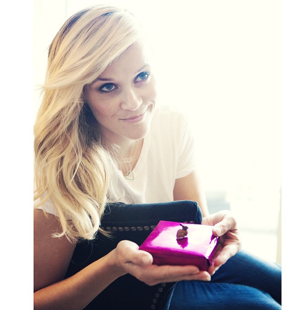Reese Witherspoon's friend gifted her a bunny foot as a token of good luck before she stepped into her Calvin Klein metallic dress. She revealed that it took 80 hours to make. @reesewitherspoon/Instagram