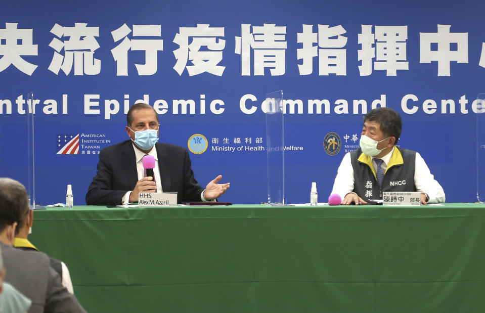 U.S. Health and Human Services Secretary Alex Azar, left, and Taiwanese Minister of Health and Welfare Chen Shih-chung answer questions from media after the signing ceremony for a memorandum of understanding at the Central Epidemic Command Center in Taipei, Taiwan, Monday, Aug. 10, 2020. Azar arrived in Taiwan on Sunday in the highest-level visit by an American Cabinet official since the break in formal diplomatic relations between Washington and Taipei in 1979. (AP Photo/Chiang Ying-ying)