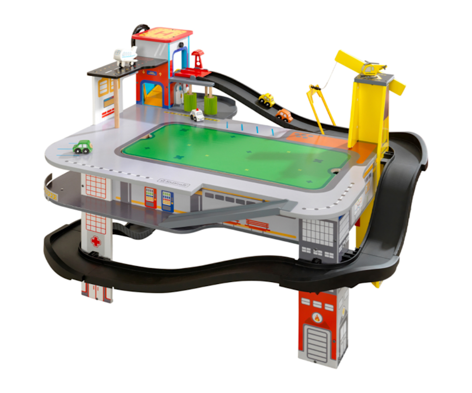 Image of a standing toy racetrack with little toy cars on the tracks.