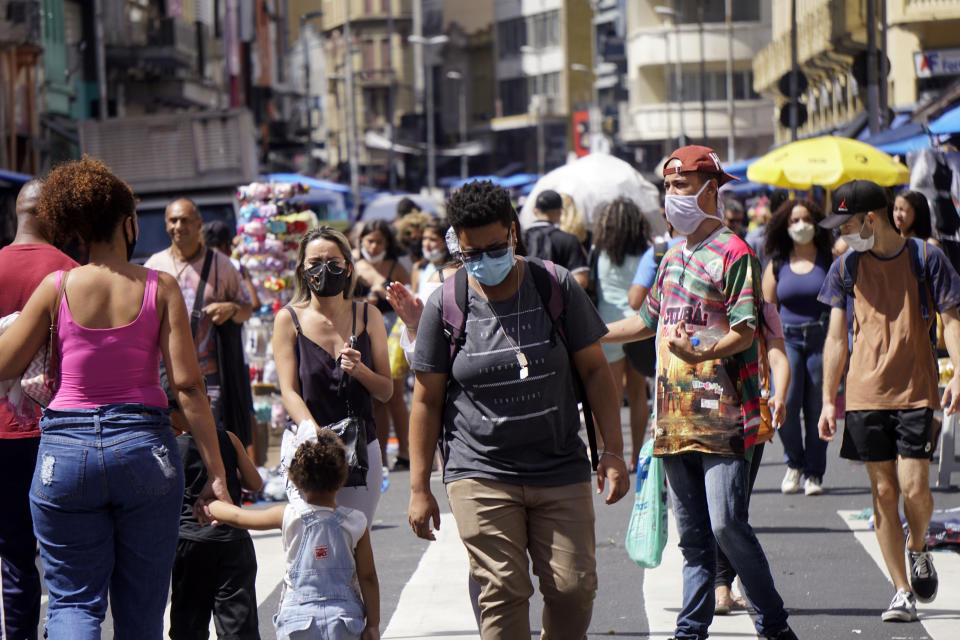 People walk through street commerce in Sao Paulo, Brazil, on March 2, 2021.  (Photo by Cris Faga/NurPhoto via Getty Images)
