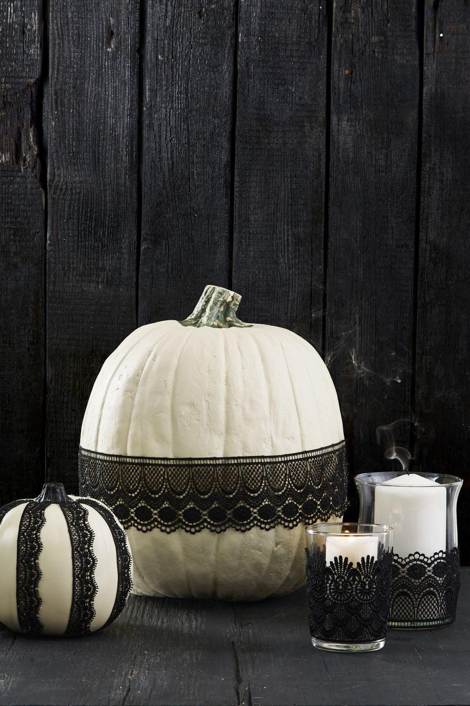 """<p>Choose ribbon or lace, then attach to pumpkins, candle holders, or even wine glasses with a few swipes of <a href=""""https://www.amazon.com/Mod-Podge-Waterbase-16-Ounce-CS11302/dp/B001IKES5O?tag=syn-yahoo-20&ascsubtag=%5Bartid%7C10055.g.1714%5Bsrc%7Cyahoo-us"""" rel=""""nofollow noopener"""" target=""""_blank"""" data-ylk=""""slk:Mod Podge"""" class=""""link rapid-noclick-resp"""">Mod Podge</a>. Let dry, then display. Done!</p><p><a class=""""link rapid-noclick-resp"""" href=""""https://www.amazon.com/ATRibbons-Delicate-Eyelash-Decoration-Ornament/dp/B07TLDTNP1/?tag=syn-yahoo-20&ascsubtag=%5Bartid%7C10055.g.1714%5Bsrc%7Cyahoo-us"""" rel=""""nofollow noopener"""" target=""""_blank"""" data-ylk=""""slk:SHOP LACE"""">SHOP LACE</a><br></p>"""