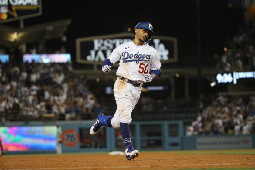 LOS ANGELES, CA - JUNE 15, 2021: a Los Angeles Dodgers right fielder Mookie Betts (50) runs the bases after hitting a solo homer to give the Dodgers a 4-3 lead in the 7th inning against the Phillies on reopening night at Dodger Stadium on June 15, 2021 in Los Angeles, California.(Gina Ferazzi / Los Angeles Times)