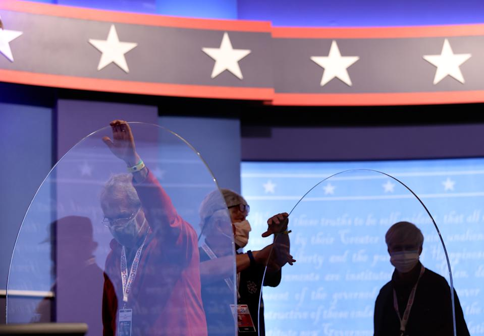 """Newly installed barriers are set up on the stage ahead of the vice presidential debate in Salt Lake City, Utah. Infectious disease experts say the plexiglass is """"infection prevention theater."""" (Photo by Justin Sullivan/Getty Images)"""