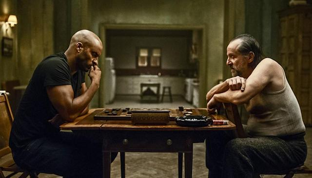 <p>Ricky Whittle as Shadow Moon and Peter Stormare as Czernobog in Starz' <i>American Gods</i>.<br><br>(Photo: Starz) </p>
