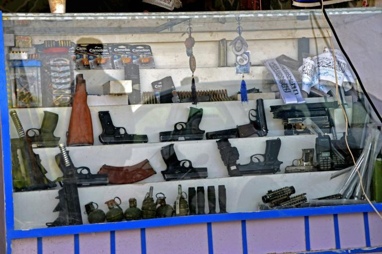 Pistols, hand grenades and ammunition are seen on display at a shop in Panjwai, Kandahar (AFP/JAVED TANVEER)
