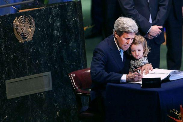 PHOTO: U.S. Secretary of State John Kerry holds his two year-old granddaughter Isabel Dobbs-Higginson for the Signing Ceremony for the Paris Agreement climate change accord at the United Nations, April 22, 2016, in New York City. (Spencer Platt/Getty Images, FILE)