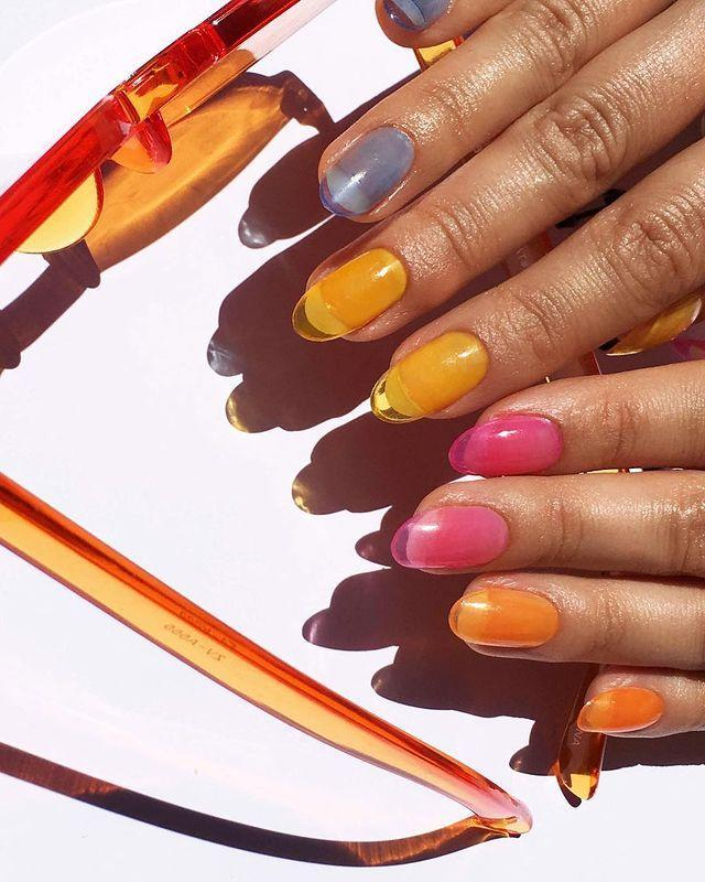 """<p>Jelly nails is a fancy way of saying invest in some translucent, pre-glued press-ons like <a href=""""https://www.sallybeauty.com/nails/nail-color/press-on-nails-and-gel-strips/inspire-24-diy-pre-glued-clear-almond-nails/SBS-006344.html"""" rel=""""nofollow noopener"""" target=""""_blank"""" data-ylk=""""slk:these from Pattie Yankee"""" class=""""link rapid-noclick-resp"""">these from Pattie Yankee</a>, then paint them with your favorite sheer lacquer. Looks fancy, isn't hard, tyvm.</p><p><a href=""""https://www.instagram.com/p/BlVqrbrl1ua/"""" rel=""""nofollow noopener"""" target=""""_blank"""" data-ylk=""""slk:See the original post on Instagram"""" class=""""link rapid-noclick-resp"""">See the original post on Instagram</a></p>"""