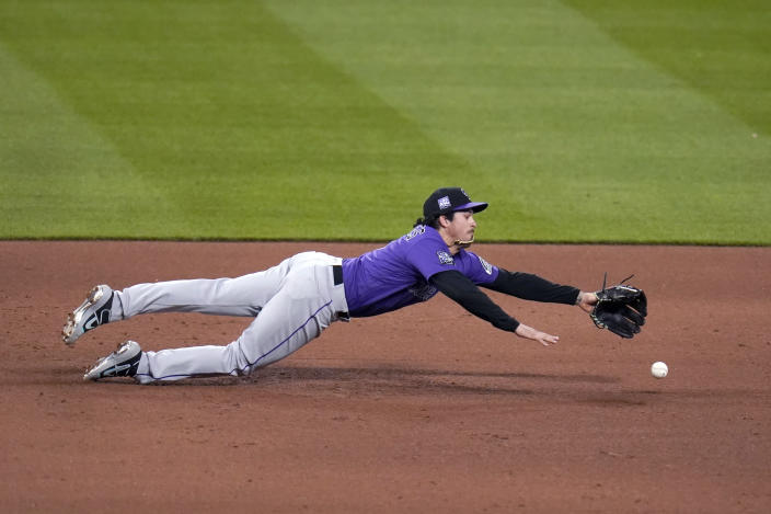 Colorado Rockies third baseman Josh Fuentes is unable to reach a single by St. Louis Cardinals' Tommy Edman during the fifth inning of a baseball game Friday, May 7, 2021, in St. Louis. (AP Photo/Jeff Roberson)
