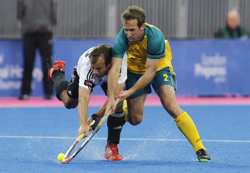 Germany's Philipp Zeller, left, competes with Australia's Liam de Young during the men's gold medal field hockey match between Germany and Australia at the Riverbank field hockey arena in the Olympic Park in London, Sunday, May 6, 2012. (AP Photo/Sang Tan)