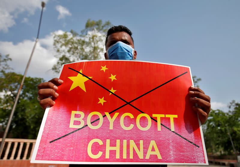 FILE PHOTO: Member of NSUI holds a placard during a protest against China, in Ahmedabad