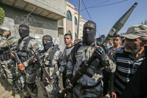 Palestinian Islamic Jihad militants attend the funeral of a comrade in the southern Gaza Strip this week